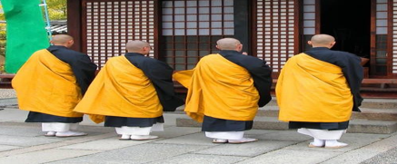 What do monks wear under their robes